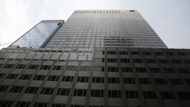 pedestrians pass by 666 fifth avenue a building owned by jared kushner's real estate company in new york new york thursday july 20 2017 photograph... - fifth avenue stock videos & royalty-free footage