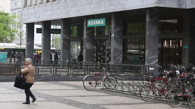 pedestrians pass by a branch of abanka bank in ljubljana, sign for abanka banking company abanka bank branch in ljubljana on may 06, 2013 in... - banking sign stock videos & royalty-free footage