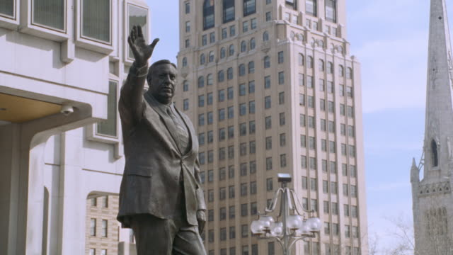 pedestrians pass by a statue of former mayor frank rizzo. - 2002 stock videos & royalty-free footage