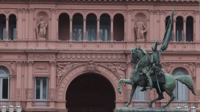 Pedestrians pass by the Casa Rosada the Argentine presidential palace in Buenos Aires Argentina Thursday July 30 2015 Shots Exterior shots of the...