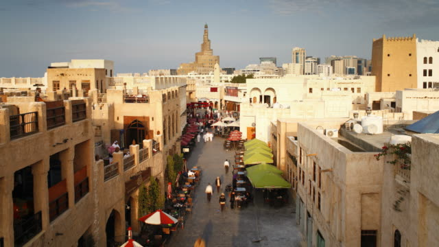 pedestrians pass shops in the restored souq waqif. - qatar stock videos & royalty-free footage