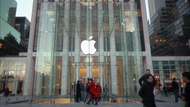 pedestrians pass the apple store and bergdorf goodman on 5th avenue. - apple store stock videos & royalty-free footage