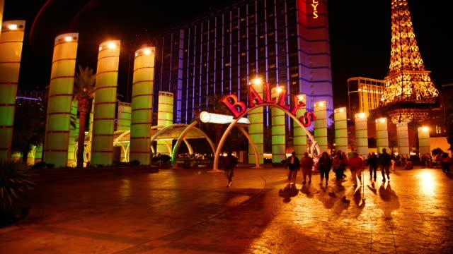 pedestrians pass the entrance of bally's casino in las vegas, nevada. - bally's las vegas stock videos & royalty-free footage