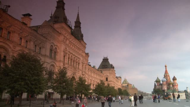 pedestrians pass the gum department store near red square in moscow. available in hd. - department store stock videos and b-roll footage