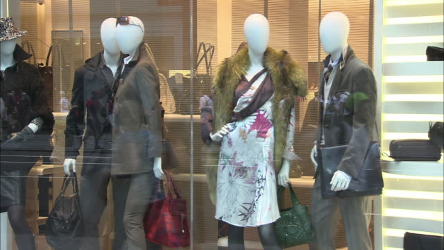 ms, pedestrians passing by clothing store window display, new york city, new york, usa - department store stock videos & royalty-free footage