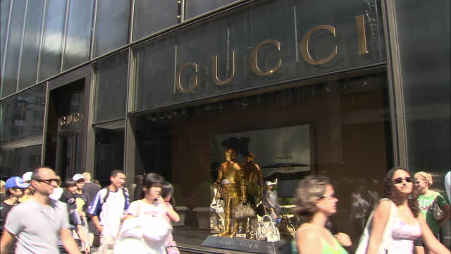 ms, pedestrians passing by gucci store window display, fifth avenue, new york city, new york, usa - fifth avenue stock videos & royalty-free footage