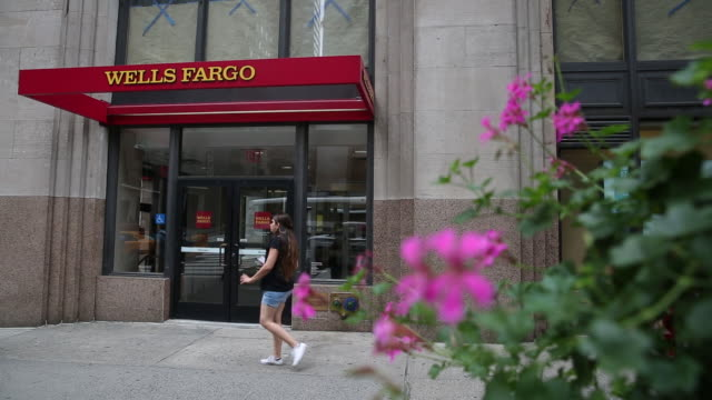 pedestrians passing entrance to wells fargo bank building new york us on tuesday july 2 2019 - wells fargo stock videos and b-roll footage