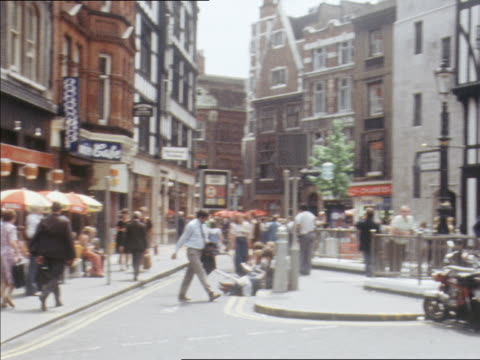 pedestrians passing liberty department store in london. - department store stock videos and b-roll footage