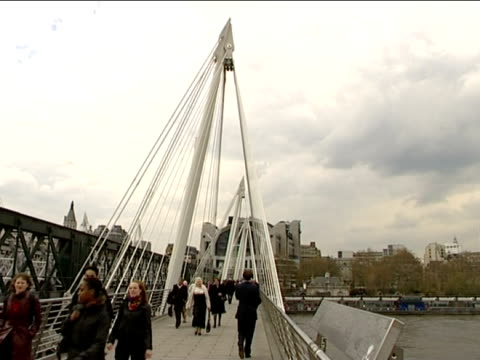 pedestrians passing over hungerford bridge london - hungerford bridge stock videos & royalty-free footage