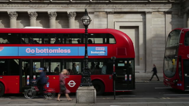 pedestrians passing red buses parked on street london uk on wednesday august 21 2019 - transportation stock videos & royalty-free footage