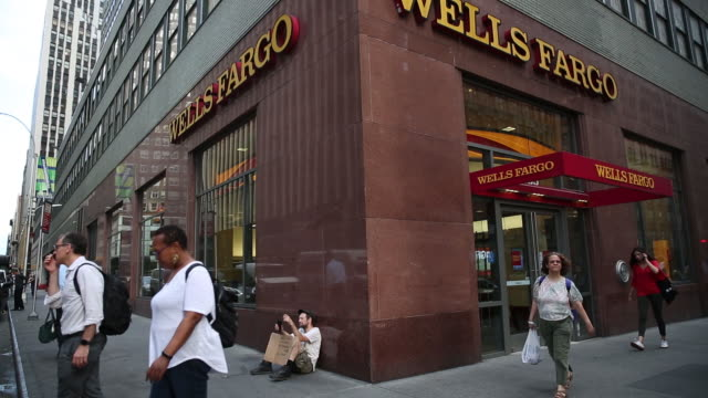 pedestrians passing wells fargo bank building new york us on tuesday july 2 2019 - wells fargo stock videos and b-roll footage