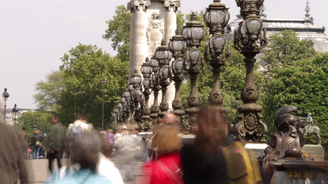t/l pedestrians pont alexandre iii crossing river seine - pont alexandre iii stock videos & royalty-free footage