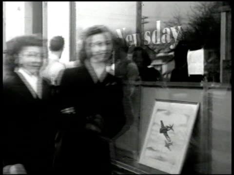 pedestrians reading news bulletins on window 'newsday.' newspaper 'fear new moslem-hindu crisis.' people reading. - new york newsday stock videos & royalty-free footage