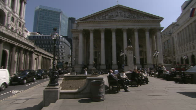 pedestrians rest on benches in a plaza outside the royal exchange in london. - square stock videos & royalty-free footage