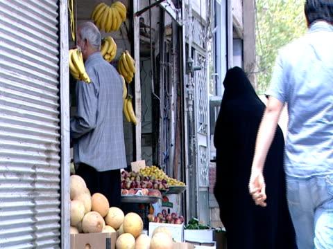 MS Pedestrians shopping in market area / Tehran, Iran