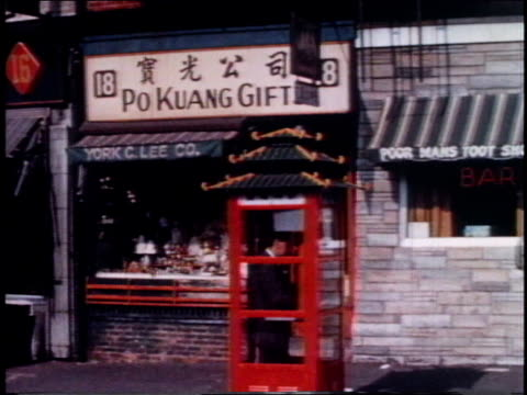 vídeos de stock, filmes e b-roll de 1962 montage pedestrians, shops, and a telephone booth in chinatown / new york, new york, united states - 1962