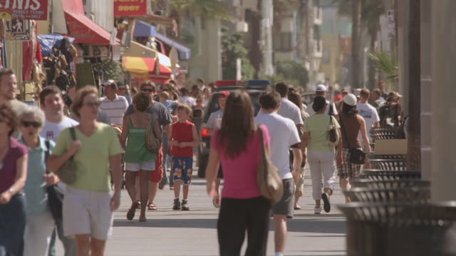 WS Pedestrians socializing and strolling through Pacific Park / Santa Monica, California, United States