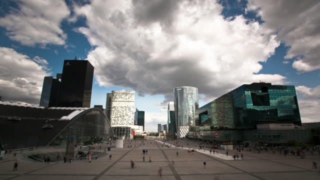 Pedestrians speed through a courtyard in the La Defense in Paris.