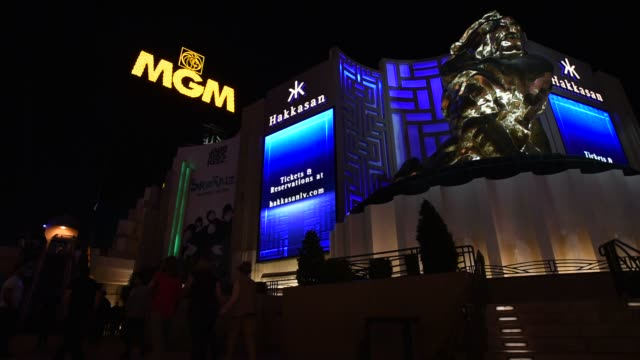 Pedestrians stand outside the MGM Resorts International Grand Hotel Casino in Las Vegas Nevada US on Tuesday Feb 16 2016 MGM Resorts International is...