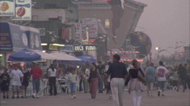 Pedestrians stroll the Atlantic City boardwalk.