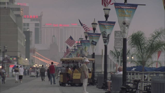 Pedestrians stroll the Atlantic City boardwalk.