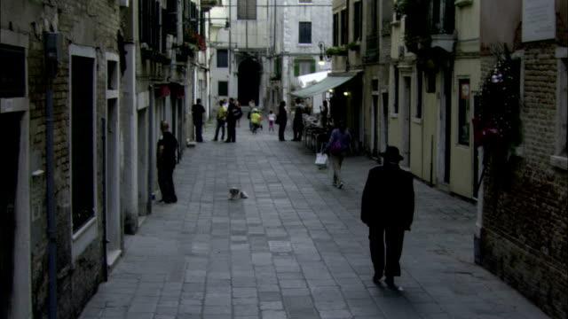 pedestrians stroll through a venice ghetto. available in hd. - ghetto video stock e b–roll
