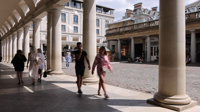 pedestrians strolling near properties owned by shaftesbury plc in covent garden. shaftesbury plc have noted an increase in demand for empty... - fashionable stock videos & royalty-free footage