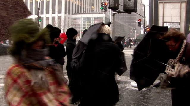 Pedestrians struggle through high winds during snowstorm Manhattan