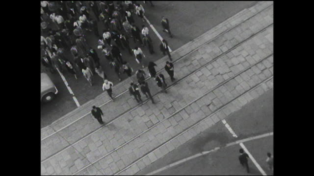 stockvideo's en b-roll-footage met pedestrians use the crosswalk adjacent to tokyo station. - 1963