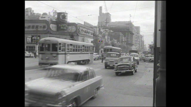 stockvideo's en b-roll-footage met pedestrians wait for heavy traffic to pass in the 4-chome intersection in tokyo. - 1963