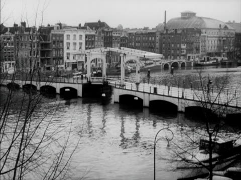 pedestrians walk across a cantilevered bridge in amsterdam - cantilever stock videos & royalty-free footage