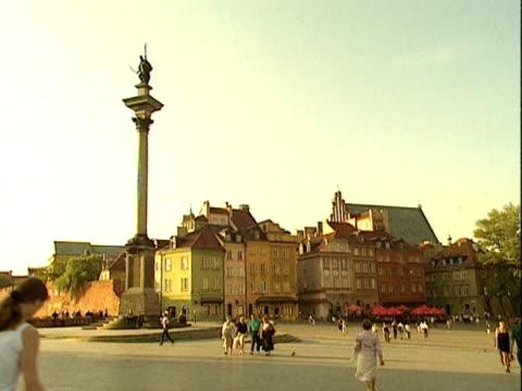 pedestrians walk across castle square, warsaw; 1999 - warsaw stock videos & royalty-free footage