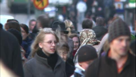 pedestrians walk along a city sidewalk. - finland stock videos & royalty-free footage