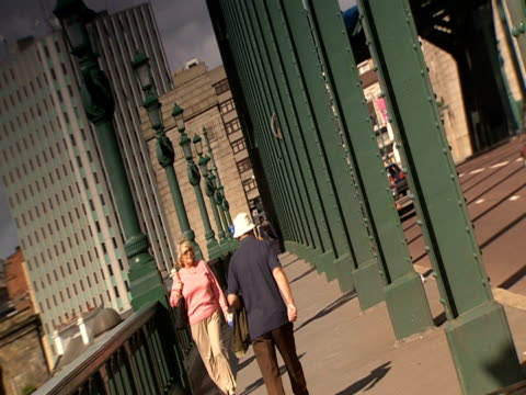 pedestrians walk along the tyne bridge. - newcastle upon tyne stock videos and b-roll footage