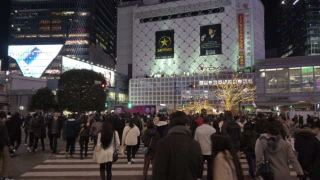 pedestrians walk at shibuya crossing in tokyo , japan . - general view stock videos & royalty-free footage