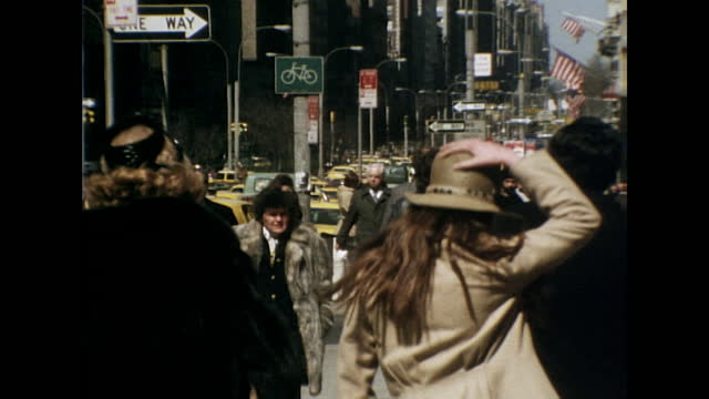 ms pedestrians walk away from/towards camera along a busy nyc street; 1975 - general view stock videos & royalty-free footage