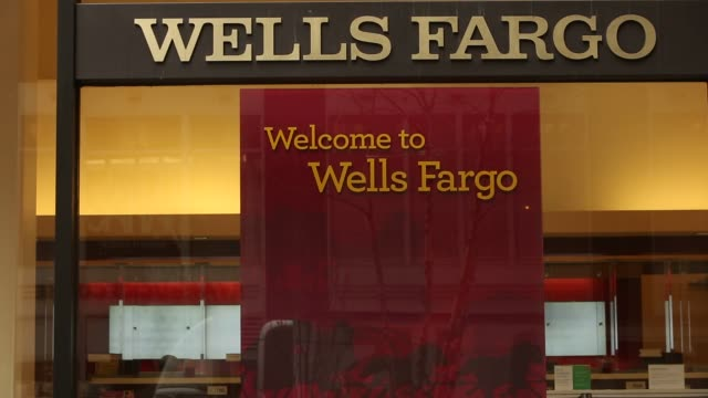 pedestrians walk by a branch of wells fargo bank in new york new york wednesday january 11 2017 shots cu of wellsfargo signage in entrance / wider... - wells fargo stock videos and b-roll footage