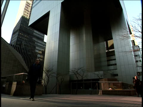 pedestrians walk by the entrance to the citicorp building in manhattan. - citigroup center manhattan stock videos & royalty-free footage