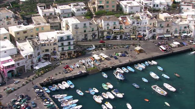 pedestrians walk down a waterfront sidewalk in capri, italy. - marina stock videos & royalty-free footage