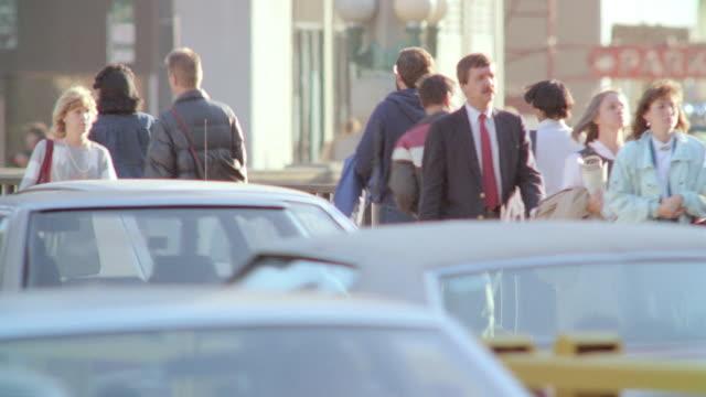 pedestrians walk down the busy sidewalks of chicago. - pedestrian stock videos & royalty-free footage