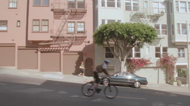 pedestrians walk on a sidewalk in a san francisco neighborhood. - pavement stock videos & royalty-free footage