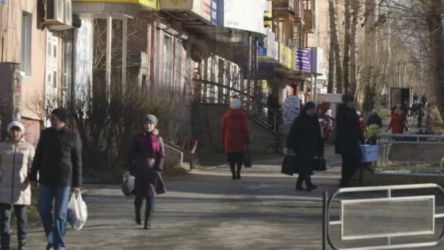 pedestrians walk on asbest street - russia stock videos & royalty-free footage