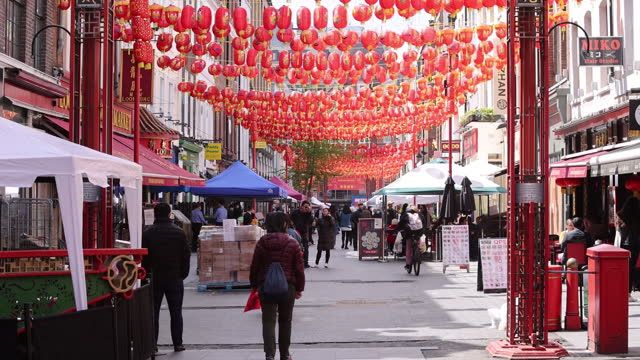 pedestrians walk on street decorated with chinese lanterns in chinatown, london, uk, on monday, may 17, 2021. - new normal concept stock videos & royalty-free footage