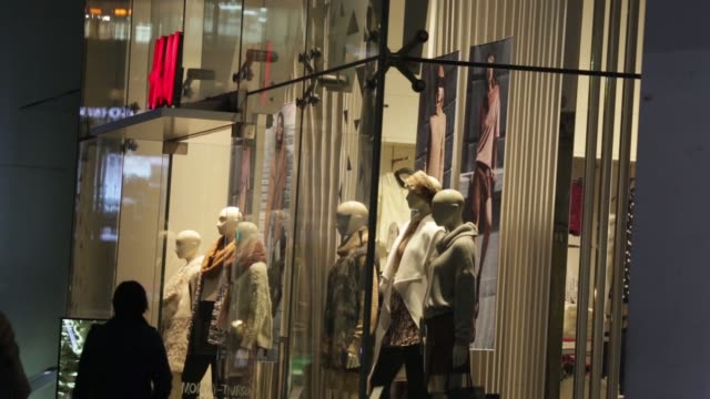 Pedestrians walk past a Forever 21 Inc store in the Harajuku district of Tokyo Japan on Thursday Nov 6 Pedestrians walk past a Hennes Mauritz AB...