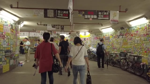 pedestrians walk past a makeshift lennon wall inside an underground tunnel at tai po district on july 20 2019 in hong kong china lennon wall message... - tunnel stock videos & royalty-free footage