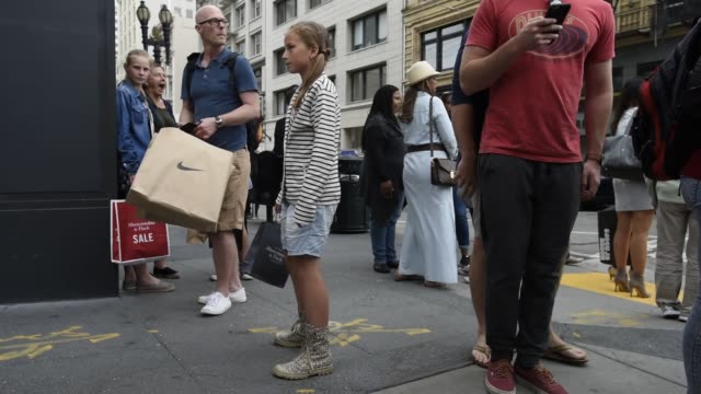 pedestrians walk past a nike inc store in san francisco, california, us, on friday, june 17, 2016 shots: nike shoes walking up to sidewalk, view of... - window box stock videos & royalty-free footage