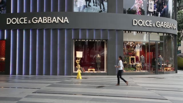 pedestrians walk past a prada spa luxury fashion store on orchard road in singapore, on tuesday, sept. 14 close up of signage for prada spa, handbags... - dolce & gabbana stock-videos und b-roll-filmmaterial