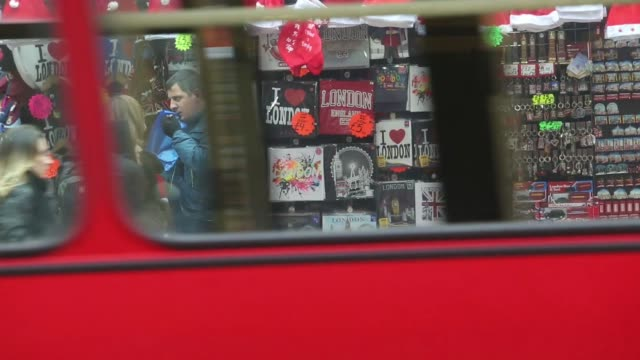 pedestrians walk past a souvenir stall on oxford street in central london uk on wednesday dec 4 a stall vendor sells christmas hats to a customer red... - kopfbedeckung stock-videos und b-roll-filmmaterial