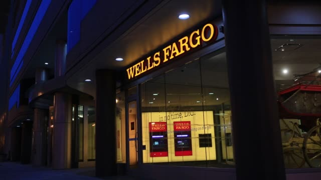 pedestrians walk past a wells fargo co bank branch in washington dc us on thursday jan 7 2016 wells fargo co is scheduled to report fourthquarter... - wells fargo stock videos and b-roll footage