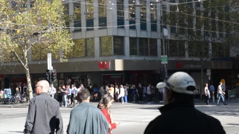 pedestrians walk past a westpac banking corp. office building, westpac logo is displayed at a bank branch window, pedestrians cross a street past a... - financial item stock videos & royalty-free footage